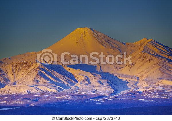 The Beautefull view on Avachinsky volcano in Kamchatka peninsula on the sunset - csp72873740