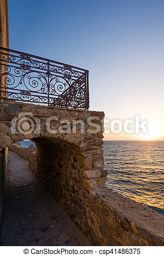 The beautiful Byzantine castle town of Monemvasia in Laconia at sunset - csp41486375