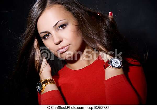 The beautiful girl with a wrist watch - csp10252732