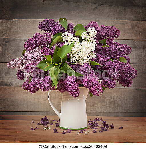 The beautiful lilac on a wooden background - csp28403409