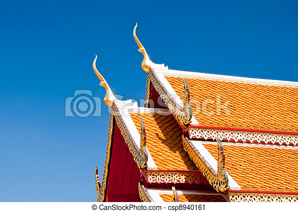 The Beautiful roof of temple on blue sky background - csp8940161