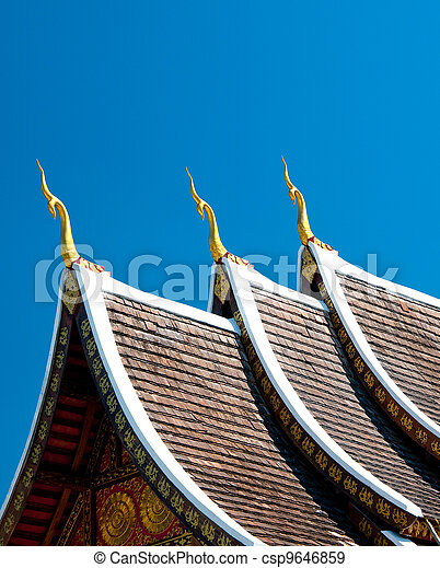 The Beautiful roof of temple on blue sky background - csp9646859
