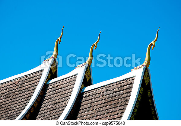 The Beautiful roof of temple on blue sky background - csp9575040
