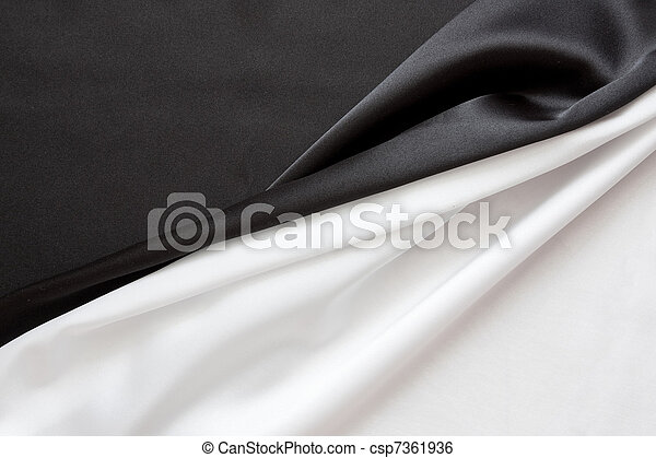 The beautiful silky brilliant black and white wavy fabric halved - csp7361936