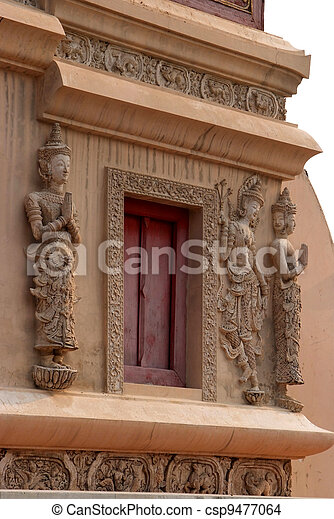 The beauty of Thai architecture and Angel statue at Scripture Repository Wat Phra Singh, Chiang Mai. - csp9477064