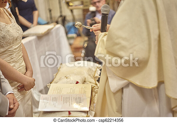 The blessing of wedding rings. - csp62214356