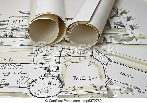 The blueprint of a house with two paper rolls the blueprint of a house csp6372762 malvernweather Choice Image