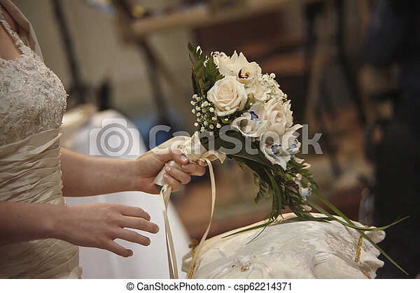 The bouquet in the hands of the bride - csp62214371