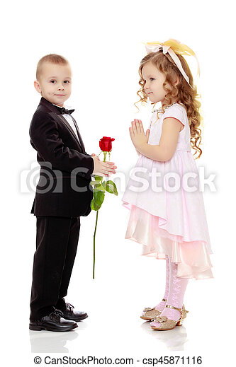 28eb59bf0e55 The boy gives the girl a flower. Little boy in black suit with bow ...