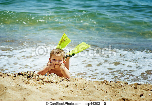 the boy on the beach with a snorkel and fins - csp44303110
