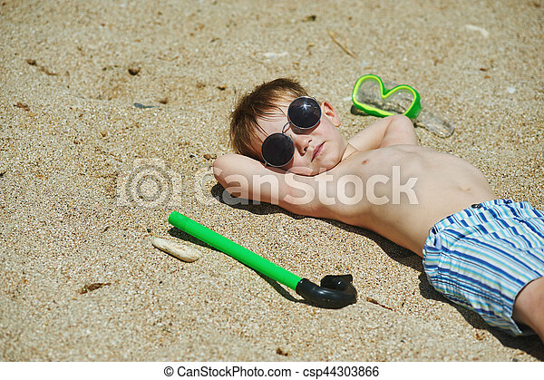 the boy on the beach with a snorkel and fins - csp44303866