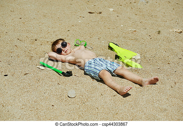 the boy on the beach with a snorkel and fins - csp44303867