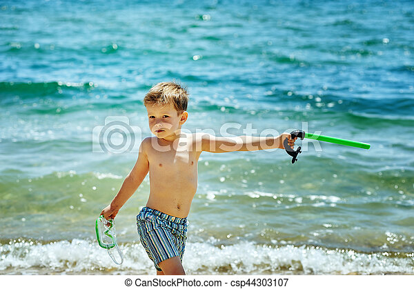 the boy on the beach with a snorkel and fins - csp44303107