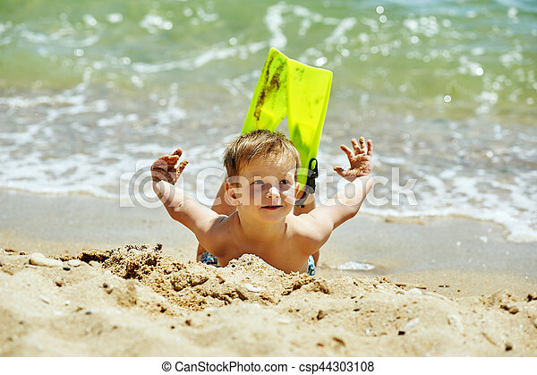 the boy on the beach with a snorkel and fins - csp44303108
