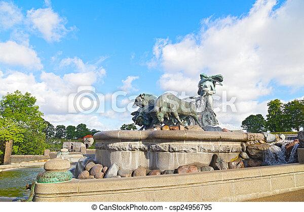 The bronze fountain depicting Norse goddess Gefion, Copenhagen, Denmark. The Gefion Fountain with raging bulls on the harbor front in Copenhagen. - csp24956795