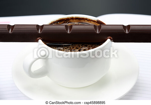 the chocolate melted on white hot Cup with black coffee - csp45898895