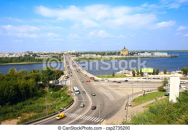 The city bridge through river with stream of cars - csp2735200