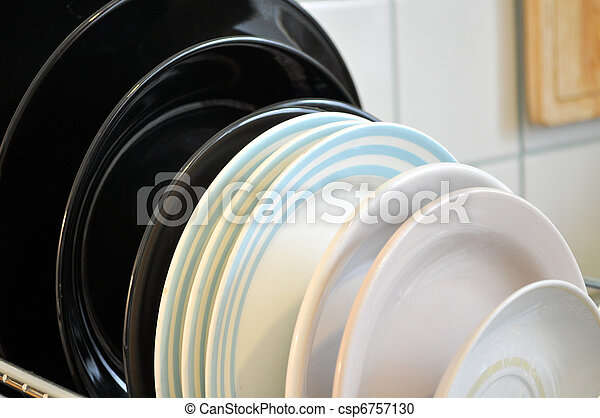 the clean dishes on the rack - csp6757130
