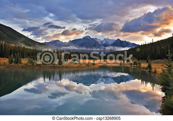 The cold lake, forest and snow mountains in Canada - csp13268905