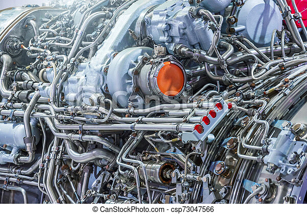 The complex mechanism of tubes and other binder systems in an airplane jet engine, close-up view. Industrial Production Theme. - csp73047566