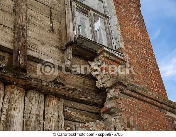 The destruction of the facade of an old wooden house - csp69975705
