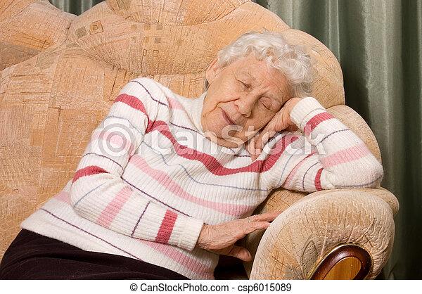 The elderly woman sleeps on a sofa - csp6015089