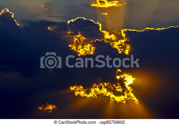 the expressive contrast of the clouds in the sky. sunset with bright clouds - csp85759602
