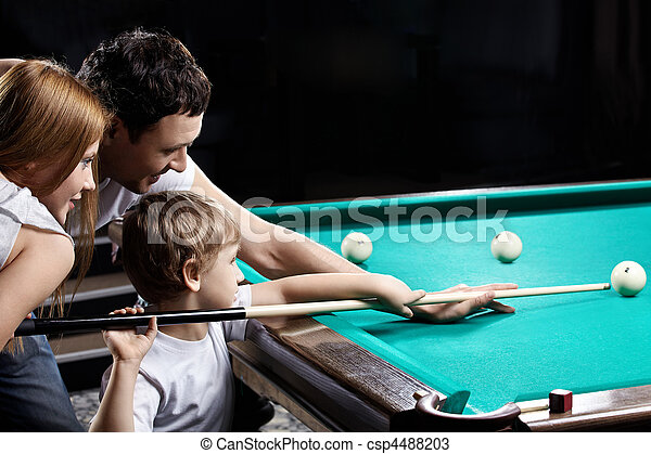 The family plays billiards - csp4488203