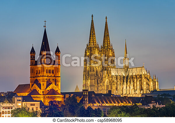 The famous cathedral and Great St. Martin Church in Cologne - csp58968095