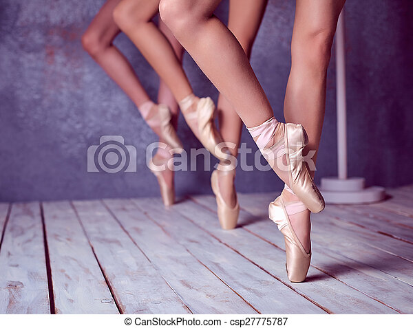 The feet of a young ballerinas in pointe shoes - csp27775787