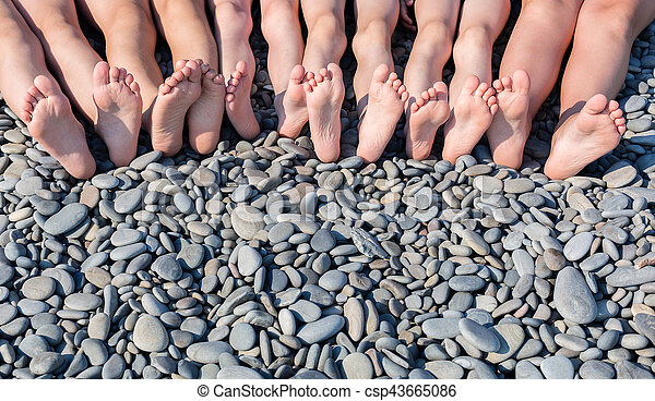 The feet of children on the beach. - csp43665086