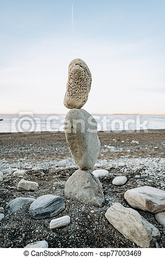 The figure of stones standing on each other, on the beach against the sea. - csp77003469
