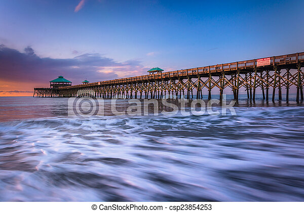 The fishing pier at sunrise, in Folly Beach, South Carolina. - csp23854253