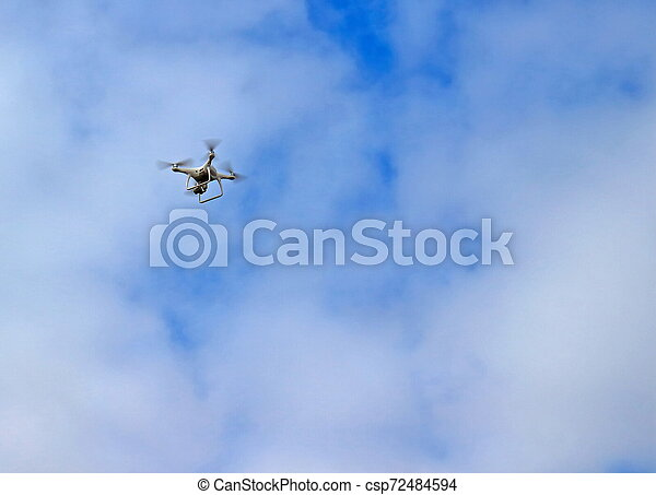 The flight of the copter in the sky - csp72484594