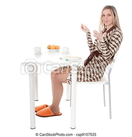 The girl behind a dining table - csp9107533