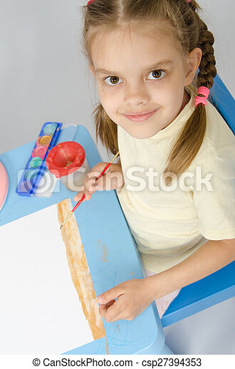 The girl drew a picture on ground - csp27394353