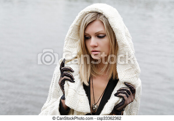 The girl in despair and grief against the river - csp33362362