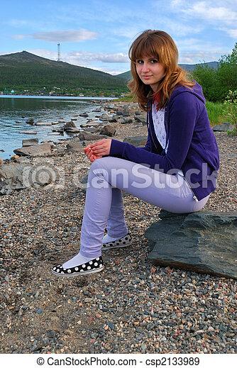 The girl sitting on coast - csp2133989
