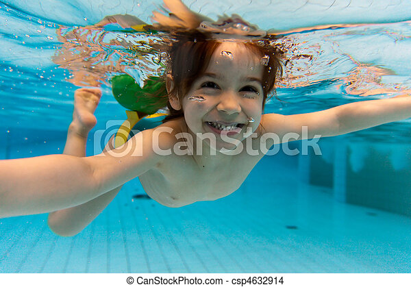 The girl smiles, swimming under water in the pool - csp4632914