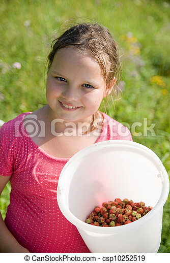 The girl with a bucket with a strawberry - csp10252519