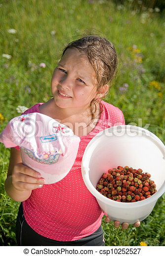 The girl with a bucket with a strawberry - csp10252527