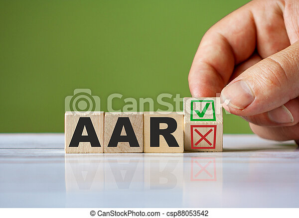The hand turn wooden block with red reject X and green confirm tick as change concept of AAR. Word AAR against all risk conceptual - csp88053542