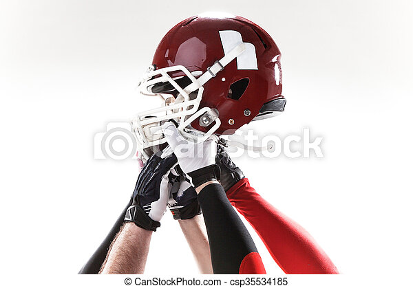 The hands of american football players with helmet on white background - csp35534185