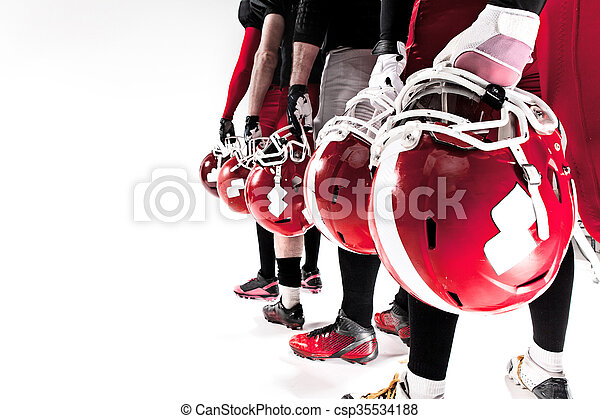 The hands of american football players with helmets on white background - csp35534188