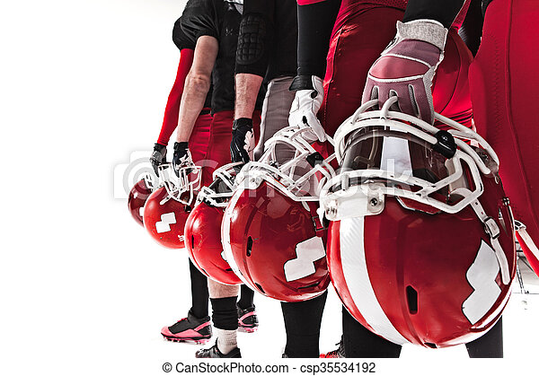 The hands of american football players with helmets on white background - csp35534192