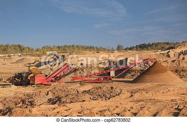 The heavy tractor works in a sand quarry - csp62783802