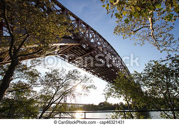 The Hell Gate Bridge and Triborough bridge behind trees, Astoria park, New York - csp46321431
