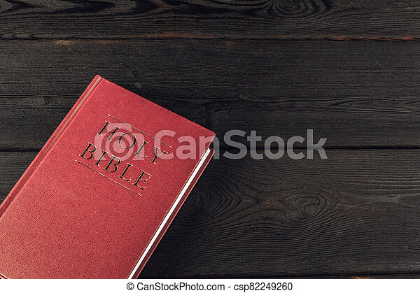 The Holy Bible on a wooden table. Close up. - csp82249260