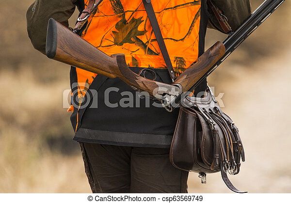 The hunter in the hunting clothes with a new hunting rifle - csp63569749