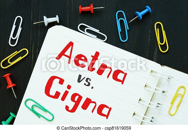 The image contains the inscription Aetna vs. Cigna on a notepad sheet. - csp81619059